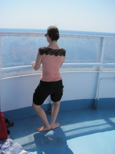 Bethany getting in some ballet stretching on a ferry!